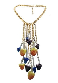Mushroom Necklace Made from hand painted ceramic pieces and gold plated chains. #MushroomNecklace #JewelryDesign #NecklaceStyle