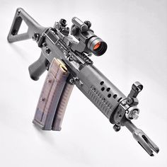 SIG SG 553 assault rifle - very versatile mid (up to 300m) to short range weapon