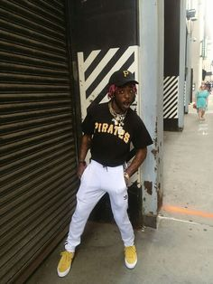 Lil Uzi Vert is a huge face in the music and fashion industry. He has exploded on to the scene and grew a mass following quickly, mostly crowded with followers from a younger audience. Here he is sporting a new style of converse, Adidas track pants, a mlb pirates shirt with a hat to match. Markus S