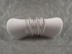 This is a set of Thin Sterling Silver bands, each set includes Two of the Tiny Dot bands, One slightly larger dot Half Bead band, and Four of the