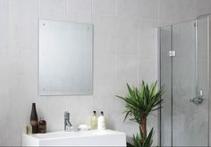 These marble effect wall tiles would look lovely if fitted landscape instead of portrait as shown here. The RRP is £18.75 per m2 from Walls & Floors. Product code is 5187 if you go on their site and search for them.