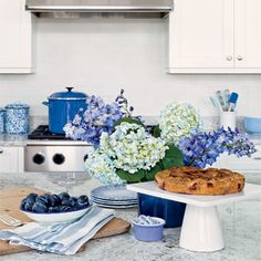 Form meets function in this kitchen, where even everyday items such as cookware and canisters act as bright blue accessories. | Coastalliving.com