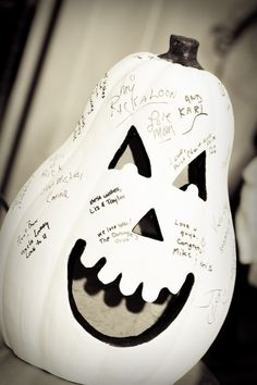 Now this is a cool guestbook alternative with a Halloween edge. Ceramic pumpkin + Sharpies = permanent spooky memories.