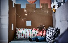 Cardboard idea: a playful privacy wall---  Got lots cardboard? We do! Whether it's a castle or a fort, this foldable wall creates a cute space for alone time and play time.