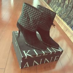 Anne Klein Suede Ankle Tie Booties black genuine suede and quilted satin ankle booties in EXCELLENT condition! suede drawstring tie at ankle for adjustable fit. tread sole. approximately 3 inch heel height. tighter/narrow fit. original box included, $258 price written on it. received as a gift from a friend about 10 years ago and never wore them, but the style is still awesome! these boots have been in storage ever since and they deserve a happy home! I'm not interested in trading, thank…