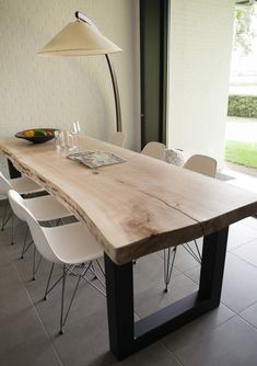 What about a live edge table with modern seating? If you are having one built this could be a possibility. Home, Kitchen Decor, Dining Table, Live Edge Table, House Interior, Home Kitchens, Dining Room Table, Rustic Dining Table, Dinning Room Tables