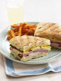 Crunchy pickles, gooey cheese, pork, and ham makes these warm sandwiches great for both lunch and dinner.