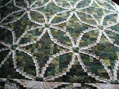 Shoreline Log Cabin, designed by Judy Martin, pieced by Gayle Day. Beautiful piecing and quilting! The pattern is in Judy Martin's Log Cabin Quilt Book.  Flickr - Photo Sharing!