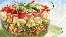 This Layered Tortellini Pesto Chicken Salad looks beautiful but I wonder how well it serves up. Seems like items on top would be captured but people wouldn't make it to the bottom level.