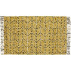 Moroccan-style rug abstracts an almost animal print. Plush yellow shag steps super-soft in handwoven New Zealand wool while black lines zig-zag an organic graphic.