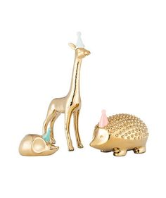 """Place these """"party animals"""" in your kid's room. They're playful, but the gold tone gives them a little bit of sophistication."""