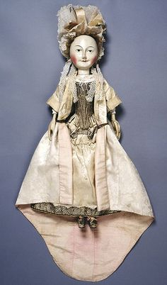 Lady Clapham doll, fully dressed England 1690s Wooden doll dressed in muslin, silk, cotton and lace Museum no. T.846-1974