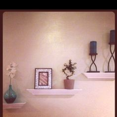 Living Room Floating Shelves  Ikea: bonsai, orchid, and vase Kohl's: shelves (w/ built-in leveler for each shelf), frame, candle holders, and candles