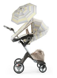 Keep your baby cool this summer! The Stokke® Xplory® Summer Kit is designed to help babies and kids keep cool even in the most sweltering summer conditions... By opening up the sides of the rear ventilated canopy, you can help your child get the best out of lovely long summer days. NEW COLOR FOR 2014! Grey Lemon Stripes