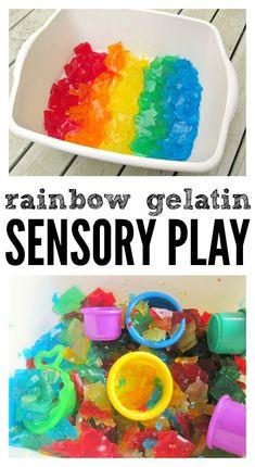Rainbow gelatin sensory tub fun for kids.