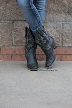 Very Volatile | Denver Cowgirl Boots Black/Grey This contemporary Western boot has all the sassy style you need. Burnished synthetic upper with tooled shaft detail. Lightly cushioned foot bed. Flexibl