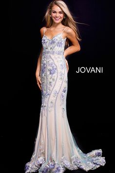 905f7df2107 Floor length form fitting multi color beaded and floral embroidered prom  dress with nude underlay features