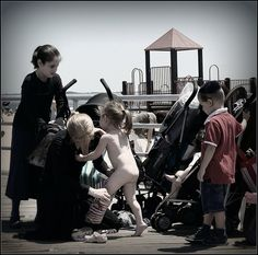 Orthodox Jewish woman dresses her youngest children to play at ...