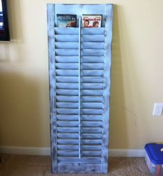 This old shutter was painted and repurposed to be a DVD holder. http://hative.com/creative-diy-cd-and-dvd-storage-ideas-or-solutions/