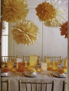 I like the paper pom-poms as ideas for decorations throughout the ballroom.  Also the colored glass candle holders would not be hard to do, and could accent with fall leaves.