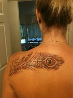 Feather tattoo with a saying down the middle. I don't usually care for tattoos but this one caught my eye!