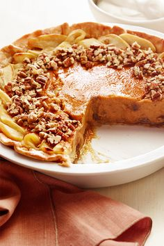 Can't decide between apple, pumpkin or pecan pie? You don't have to with this dessert that features the best parts of them all in just one slice! Apple Pecan Pie, Pumpkin Pecan Pie, Pumpkin Pie Recipes, Pumpkin Dessert, Pumpkin Cheesecake, Pecan Desserts, Desserts To Make, Fall Desserts, Traditional Thanksgiving Recipes