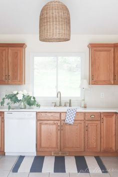 How to create an updated look without painting the oak cabinets in your kitchen | Featuring a Delta Cassidy Faucet (via Julie Blanner)