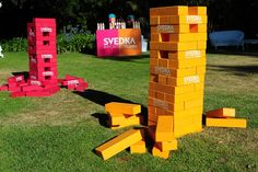 """Guests played """"life-size Jenga"""" using huge game pieces stamped with the name of…"""