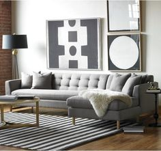 light grey tufted sectional. Fur throw. Tall lamp on side opposite chaise of sectional helps balance it out.  Couch sofa
