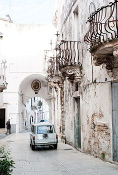 Beautiful old balconies down the rugged white streets of Puglia, Italy