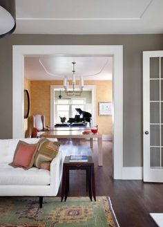 Wide flat baseboards and trim. contemporary living room by Tim Cuppett Architects