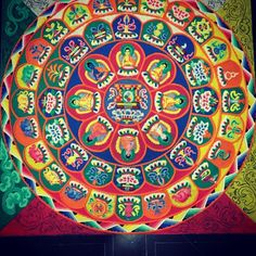 The center of the #MedicineBuddha sand mandala being created at #TibetanGallery by the monks of @Mystical Arts of Tibet.