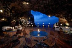 The town of Polignano a Mare in Bari, southern Italy, offers a unique dining experience at the Grotta Palazzese. Open only during the summer months, a restaurant is created inside a vaulted limestone cave, looking outwards toward the sea. The restaurant is part of the Grotta Palazzese hotel located above. (HT Silouan)