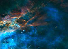 """A NASA Hubble Space Telescope """"true color"""" mosaic image of a small portion of the Orion Nebula, taken the Wide Field and Planetary Camera.  This color photograph is a composite of separate images taken at the wavelengths of three abundant elements in the nebula: Hydrogen, Oxygen and Nitrogen. The images were taken August 13 and 14, 1991."""
