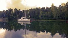 A sailing boat on a quiet bay / Midsummer night