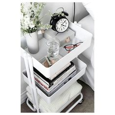 A cart like this could be a good nightstand, makeup holder etc.