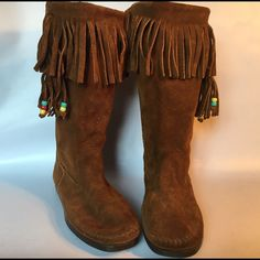 Minnetonka moccasin boots🎈HOST PICK🎈 Great rust colored moccasin boots by Minnetonka. These have been worn but are in excellent condition Minnetonka Shoes Moccasins