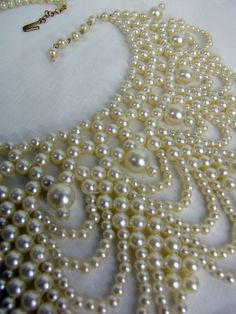 A pearl necklace. -  OH MY...GORGEOUS!  ♥A