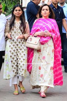 Nita Ambani and Isha Ambani cast their votes in Mumbai wearing white printed kurta palazzo suits. They both rounded out their looks with matching sandals and straight hair! Casual Indian Fashion, India Fashion, Woman Fashion, Punjabi Suits Designer Boutique, Indian Designer Suits, Embroidery Suits Punjabi, Embroidery Suits Design, Indian Wedding Wear, Indian Wear