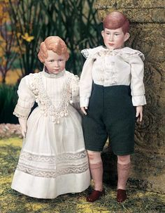 """*ROYAL CHILDREN, PORCELAIN PORTRAIT DOLLS ~ by: Martha Thompson, 12"""" + 14"""" T.  Sculpted porcelain shoulder heads depicting the young British royal children CHARLES + ANNE, each with sculpted hair, painted facial features, painted eyes in well defined eye sockets...MARKS:  Prince Charles 1960 MDT.  COMMENTS:  Martha Thompson, 1960."""