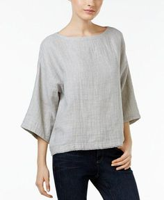 - Eileen Fisher's forever-flattering boxy top is a casual collection must. - Boat neckline - Pullover styling - Three-quarter sleeves - Boxy silhouette - Unlined - Hits at hip - Organic linen/organic