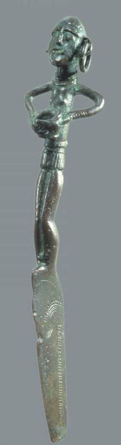 Bronze knife whose handle is made as a female figure wearing cord skirt. Found by Itzehoe in Holstein.