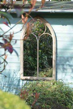 miroir de jardin en forme de fenêtre