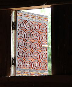 Traditional carved and painted House Shutter with Toraja pattern on a Tongkonan house in Tana Toraja, Sulawesi, Indonesia Indonesian House, Southeast Asian Arts, House Shutters, Global Style, Boho Room, Table Top Display, Elle Decor, Ancient Art, Traditional House