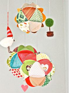 Make ornaments to look like these--cut out small circles, then fold so that there is a triangle inside the circle, then glue each circles' flaps together until a ball shape is formed.