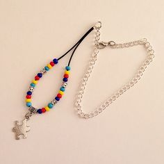 Autism Awareness Beaded Car Charm, Puzzle Piece Auto Hanging Rear View Mirror Ornament Accessory Red Blue Yellow by EverydayWomenJewelry on Etsy https://www.etsy.com/listing/231126987/autism-awareness-beaded-car-charm-puzzle