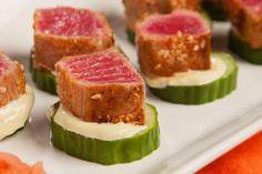 Blackened and seared ahi tuna bites with wasabi mayo on cucumbers.