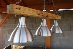 Chandelier made from three aluminium lights and a log. Suitable for as a gazeebo or patio lighting.