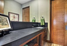 Modern Bathroom: organic materials, natural materials, modern bathroom, modern vanity sink, wood veneer cabinets, modern cabinet, modern under vanity open shelves, modern vanity pulls, modern faucet, modern fixtures, stained wood interior doors, travertine floor.