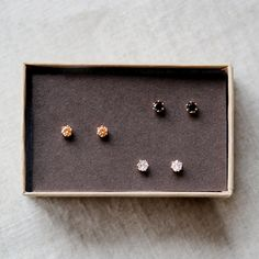 nova trio - tiny gold stud earrings by elephantine. $60.00, via Etsy.